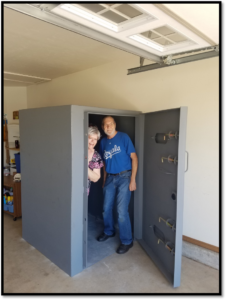 Homeowners Standing Inside a Garage Aboveground Shelter