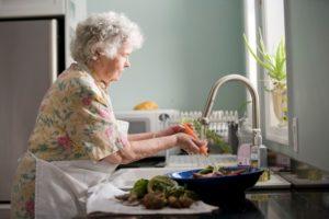old woman preparing food