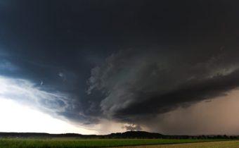 tornado above green field