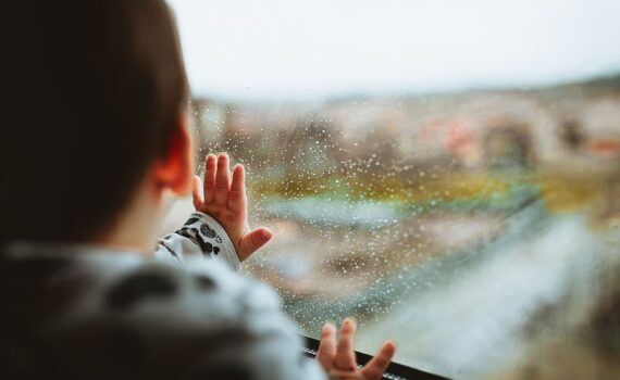 child looking at storm