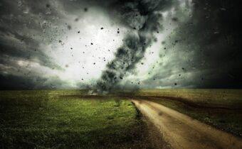tornado ripping through a field with debris