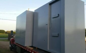 A grey colored safe room shelter in Denison, TX