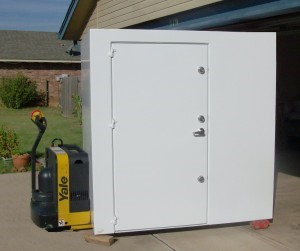 A white colored ground tornado shelter in Texas
